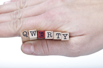 hand with QWERTY letters