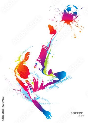 Zdjęcia na płótnie, fototapety, obrazy : Soccer player kicks the ball