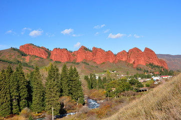 Red rocks Seven-bulls in picturesque gorge Dzhety-Oguz