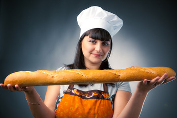 woman cook holding fresh baked bread