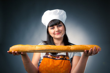 woman cook holding fresh bread