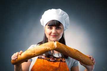 woman cook breaking a french bread