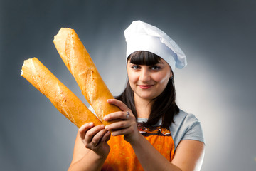 woman cook holding breaked french bread