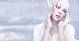 Fototapety Beauty woman over winter background