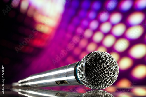 canvas print picture microphone against purple disco background