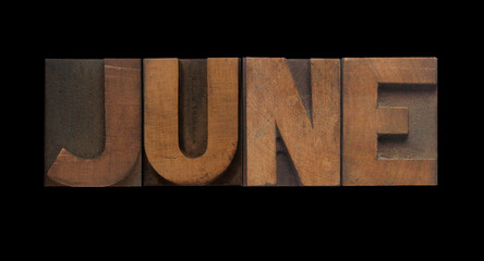 the word June in old letterpress wood type