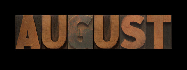 the word August in old letterpress wood type