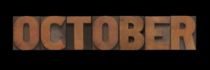 the word October in old letterpress wood type