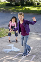 Girls playing hopscotch