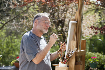 Man Painting Outdoors