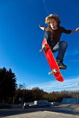 boy going airborne with his skateboard