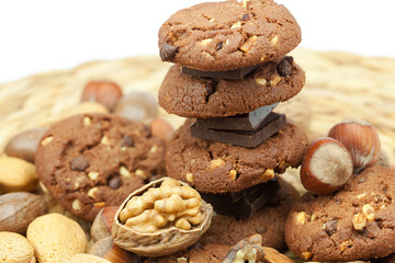 oatmeal cookies, chocolate and nuts on a wicker mat