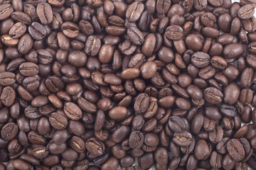 background of dark roasted fair trade coffee beans
