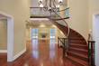 Foyer with balcony and curved staircase
