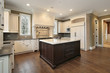 Kitchen with wood and granite island