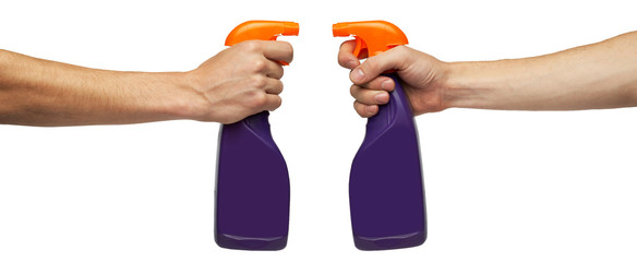 spray bottle in hand isolated on white background
