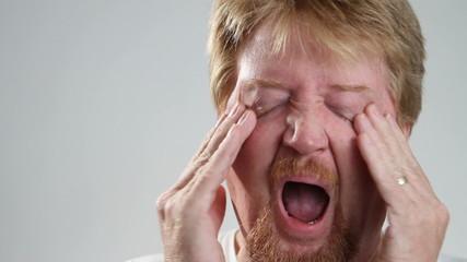 Man Yawns