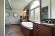 Master bath with multicolored flooring