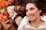 happy girl  lying on autumn leaves