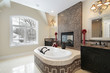 Master bath with marble tile tub