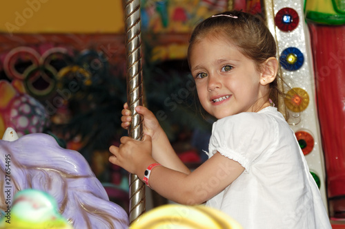 Child in carousel