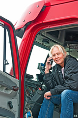 Pretty woman truck driver on phone