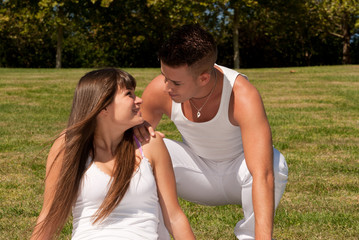 young couple happy sit on grass white clothes, love relationship