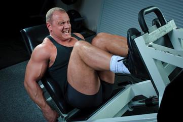 Bodybuilder training in gym