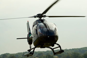 "Closeup of the landing EC-120 ""Colibri"" helicopter"