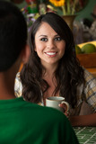 Beautiful Latina Woman with Cofee or Tea and Male Companion poster