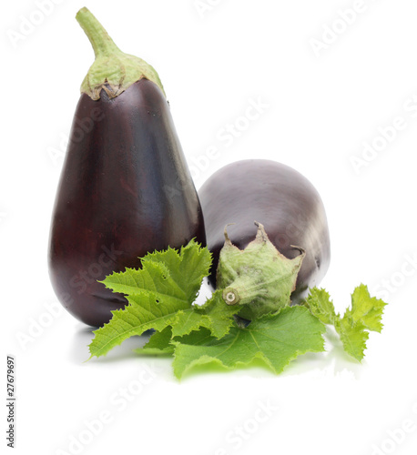 Two aubergines with leaves isolated.