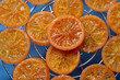 Candied orange slices on a grill