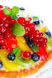 cake with fresh berries and fruit closeup