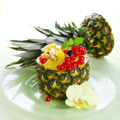 Fresh salad of tropical fruits and berries (pineapple, kiwi, pea