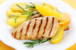 Chicken with fresh rosemary and baked apples with orange juice a