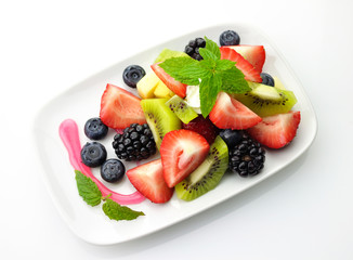 fruit salad in a white dish