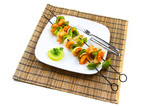 Grilled shrimp and vegetable skewers on plate