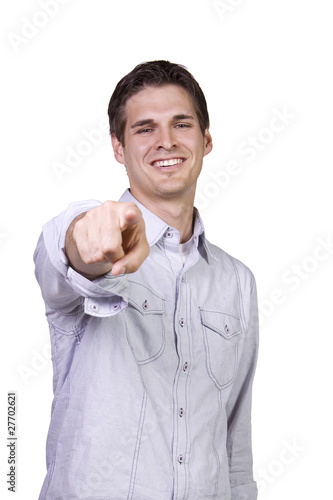 Young man smiling and  pointing finger