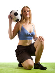 girl posing with soccer ball