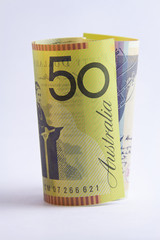 rolled up Australian 50 dollar note