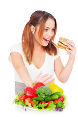 woman with tasty burger and vegetables