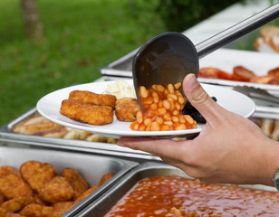 Serving of a plate of beans and nuggets