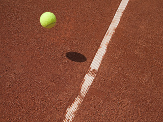 Tennis ball - in or our - on clay.