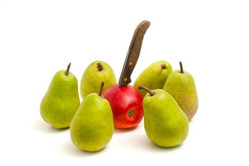 A red apple stabbed with a knife, surrounded by pears