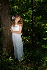 Pretty woman posing in forest