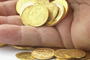 hand with gold coins