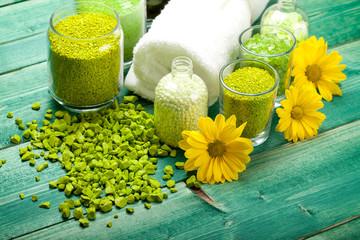 Yellow flowers and green bath salt