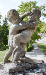 Putto fighting a Satyr