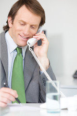 Businessman calling by phone