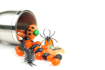 Halloween cup spilling candy